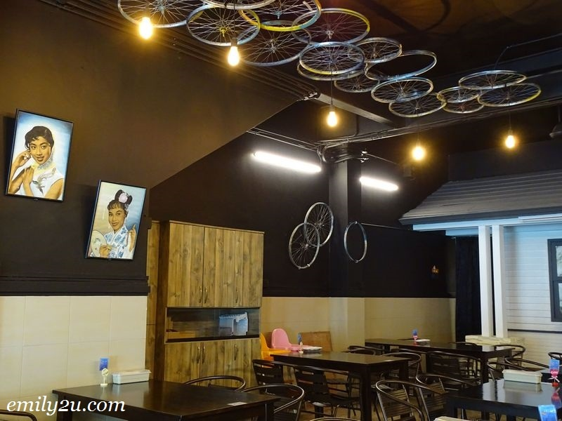 3. bicycle rims are all over the café, and also framed paintings of classic women