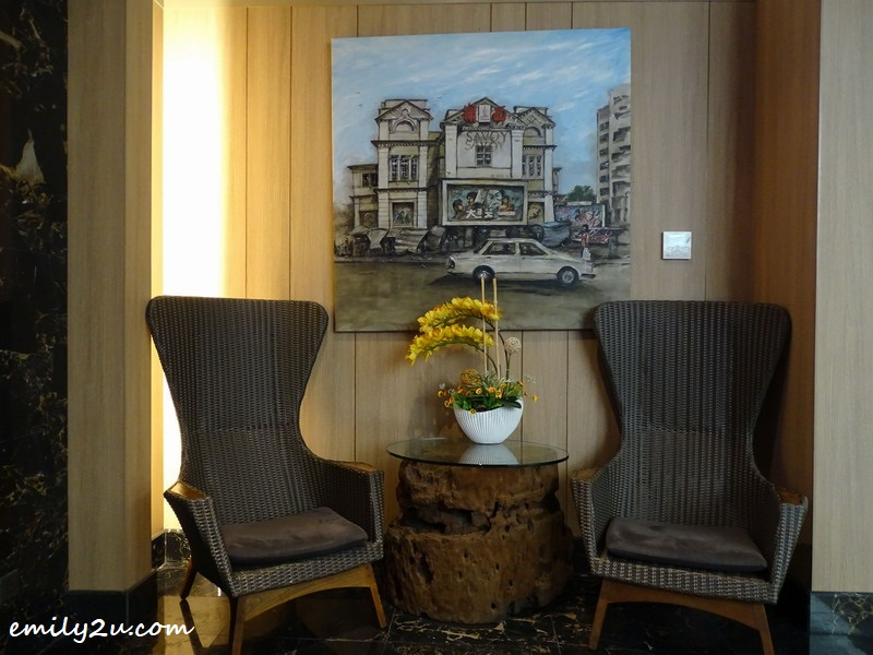 3. cosy corner with a painting of the original business of ibis Melaka, a cinema