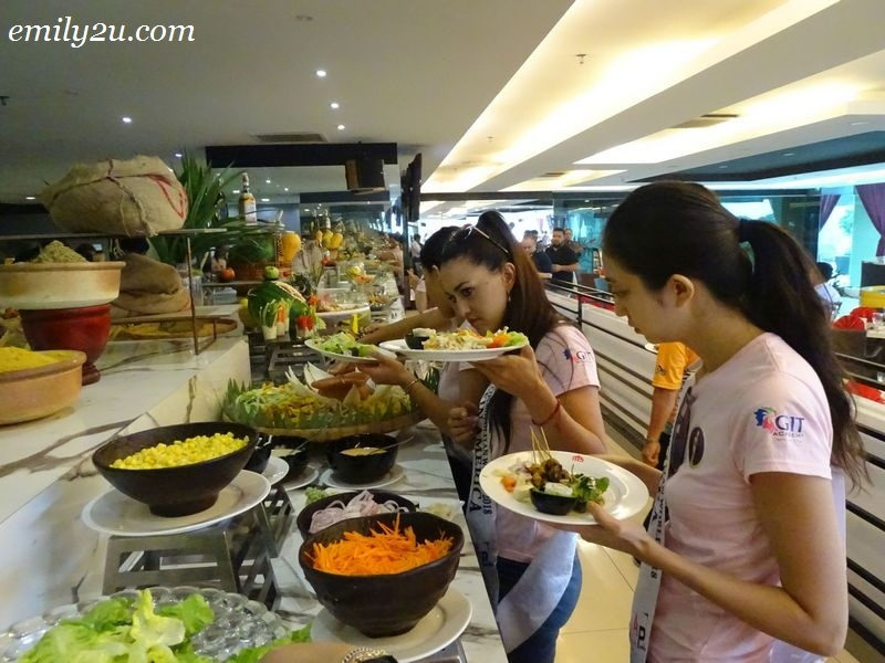 6. Miss Cosmopolitan World (MCW) 2018 Finalists getting their lunch from the buffet line