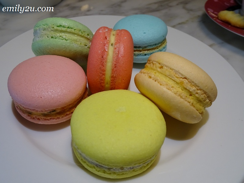 an extra plate of macarons of various flavours