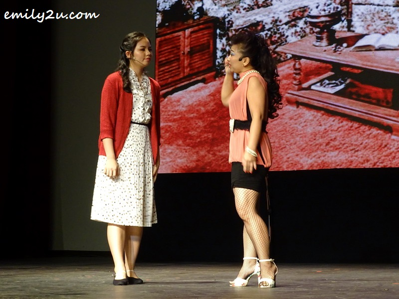 6. Matilda's teacher Miss Honey (L) looks for Matilda's mother