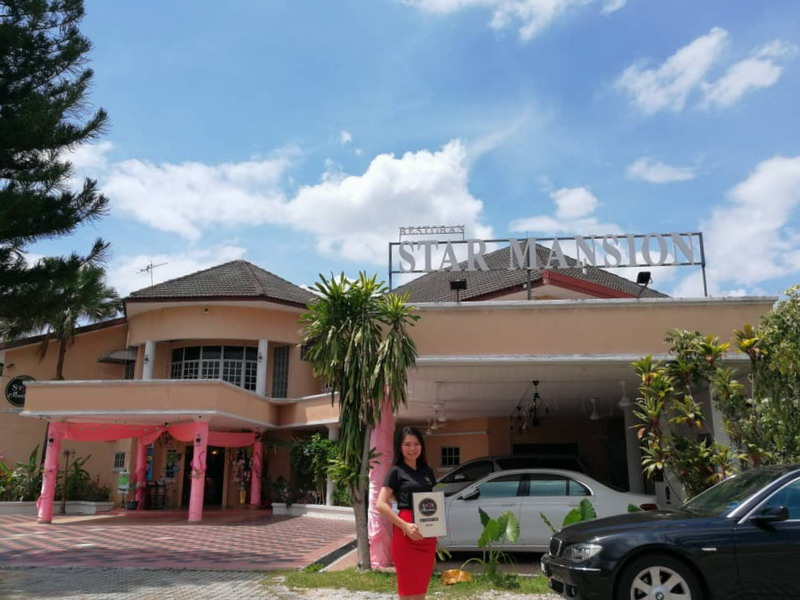 1. proprietor Ms. Christy Tan in front of Star Mansion