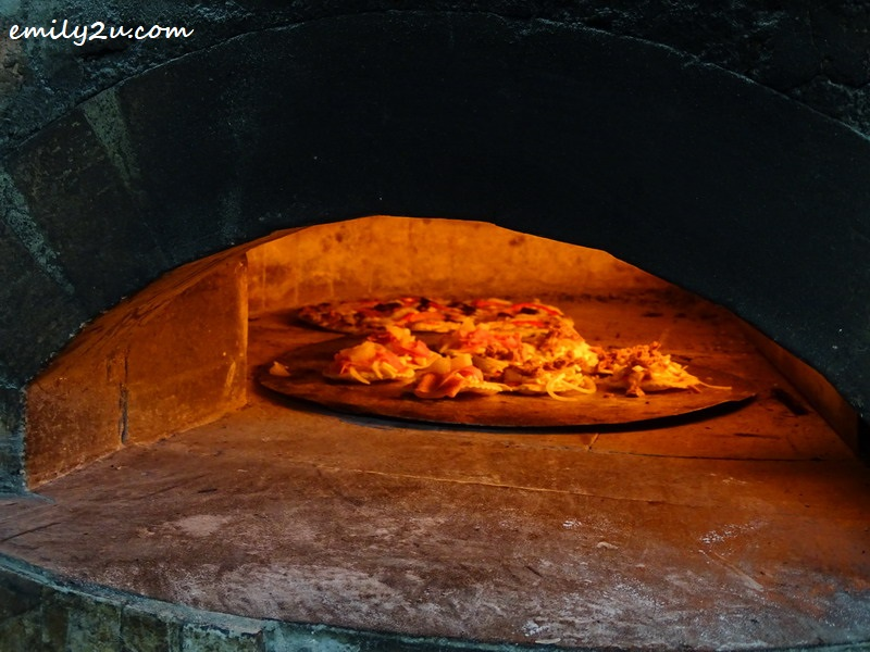17. pizza being baked in the oven