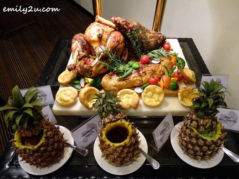 14. roast counter: beef Wellington and Brazilian pineapple BBQ lamb leg