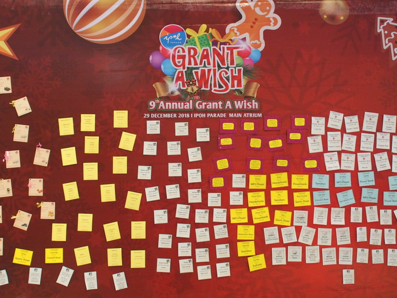 4. Grant A Wish Board with children's requests await shoppers to pick them up.