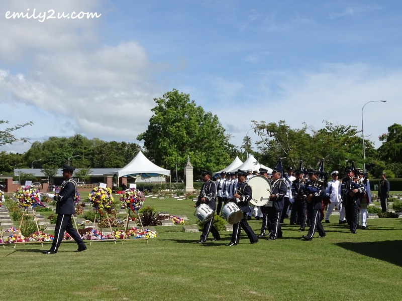 1. brass band enters the Labuan War Cemetery