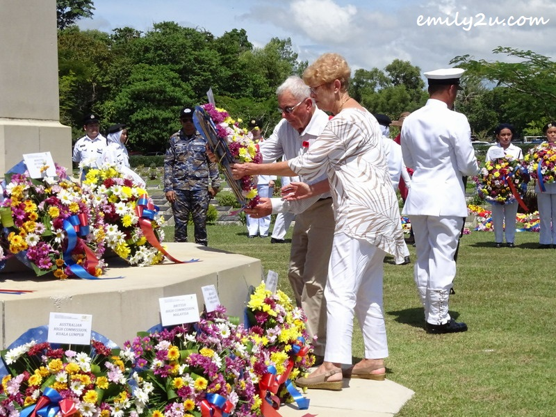 8. Wendy Currey and her husband Maurice participate in the wreath-laying ceremony