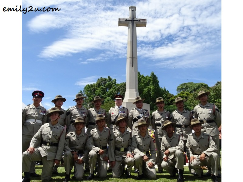 4. 2nd battalion Royal Gurkha Rifles (2RGR) based in Brunei Darussalam pose in front of the sword monument, a symbol of bravery