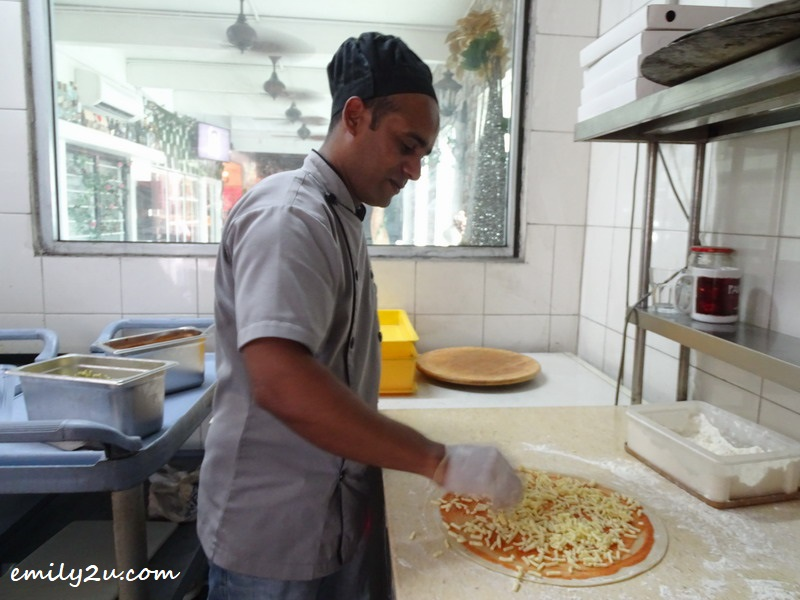 14. Chef Malek prepares pizza
