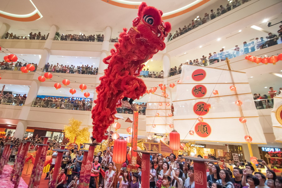 Ipoh Parade shoppers are enthralled by the acrobatic lion dance performance