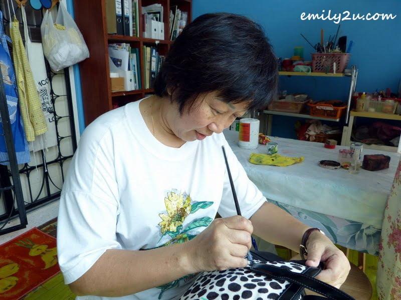 Mary Jo restoring a handbag