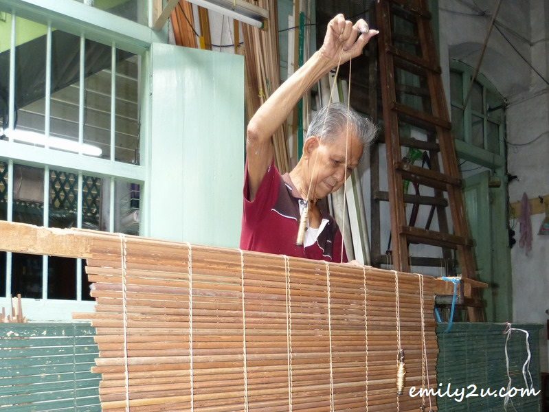 1. Lau Chee Wah weaving nipa palm and securing with nylon strings