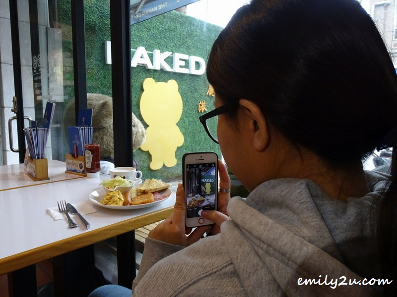 the camera appreciates the meal first at The Naked Café