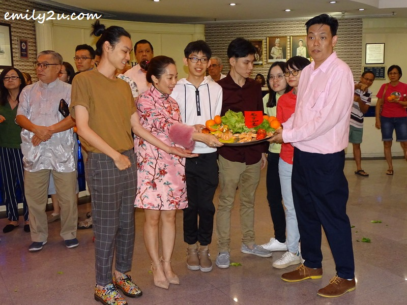 12. hotel director Mr Yan (R), Ms Elena Phor (second L), their family and friends with the good luck platter received from the lions