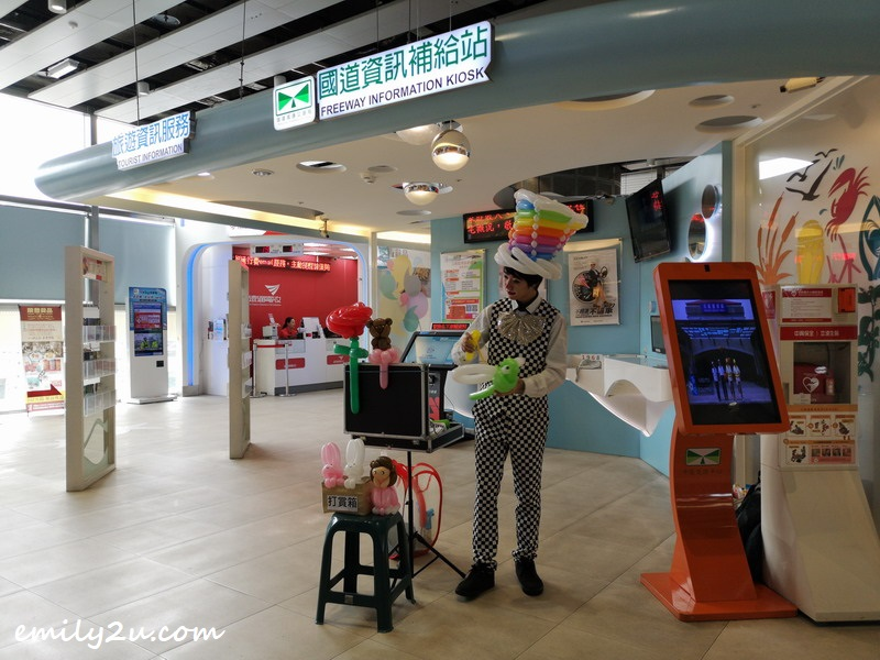 a clown at the information counter of Qingshui District Highway Rest Area