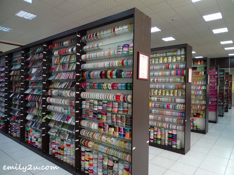 ribbons are arranged on shelves according to type and colours, like books in a library at Ribbon Museum