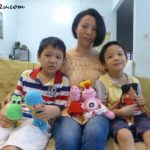 With sons Gordon (L) & Malcolm (R) and Amigurumi items (L-R) Yoshi (a character from Mario Bros), Pocoyo, Peppa Pig, Olivia