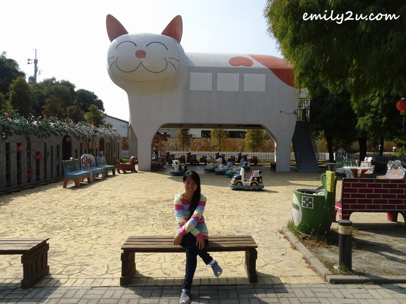 posing in front of the gigantic cat