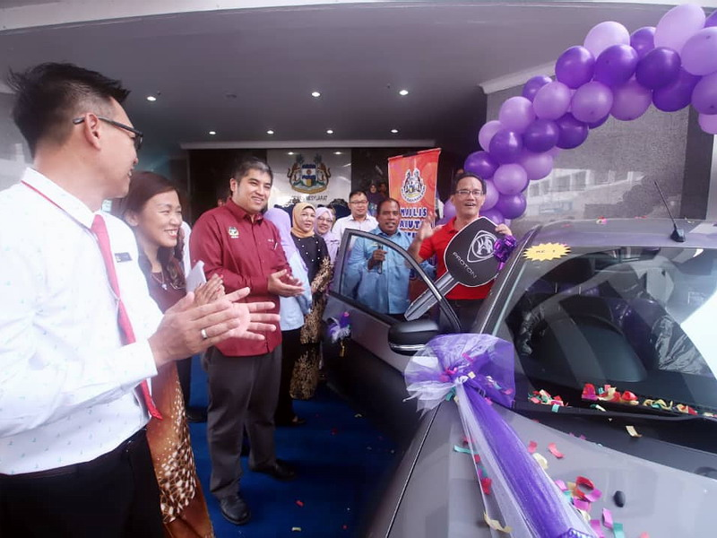 Yeoh with his prize of a Proton Saga 1.3MT