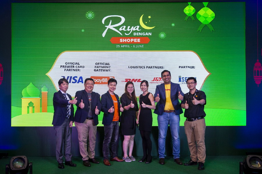 (L-R): Koji Oyama, Managing Director, Isetan; Chan Kok Long, Co-founder & Executive Director, iPay88; Zed Li, Head of Business, Shopee Malaysia; Loh Ai Chern, Senior Manager, Business Development, Visa; Marianne Chuo, Marketing Lead, Shopee Malaysia; Anil Gautam, Managing Director, DHL; and Karim, Director of VIP & Marketing, J&T Express (M) Sdn Bhd launching the Raya Dengan Shopee campaign
