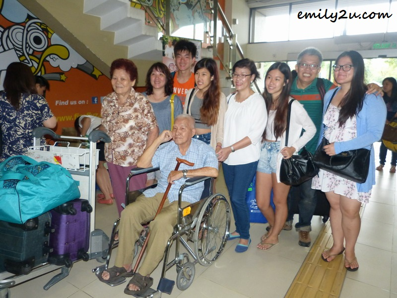 Yeow Weng Fee (in wheelchair) and his family at Subang Airport before their flight to Langkawi
