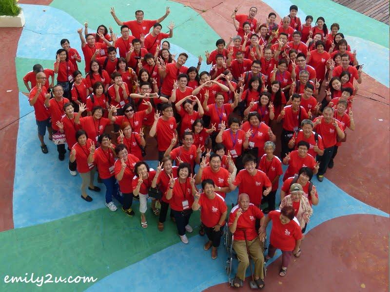 holiday-makers forming a heart shape at Resorts World Langkawi