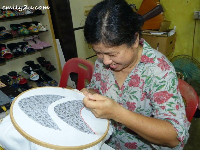 Lim's wife, Susan Hau Fong Lian, starts beading