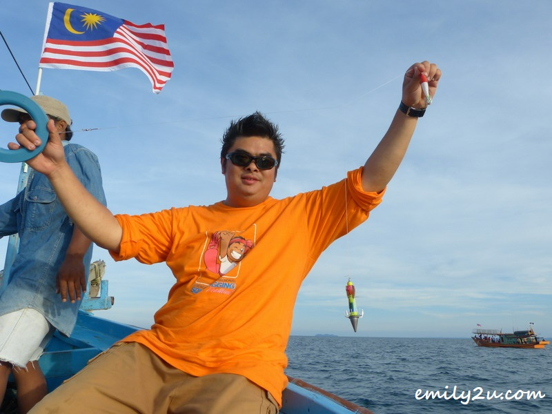 Phil Foo shows his squid jig