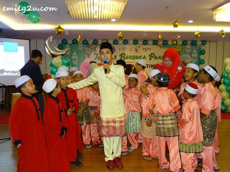Aiman Tino with some of the orphans