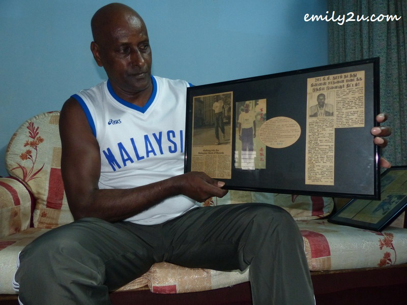 G. Deo with old newspaper clippings on his achievements