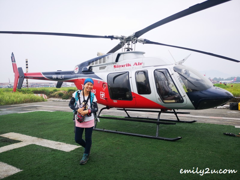 about to fly in Simrik Air's Bell 407 to Manaslu Conservation Area