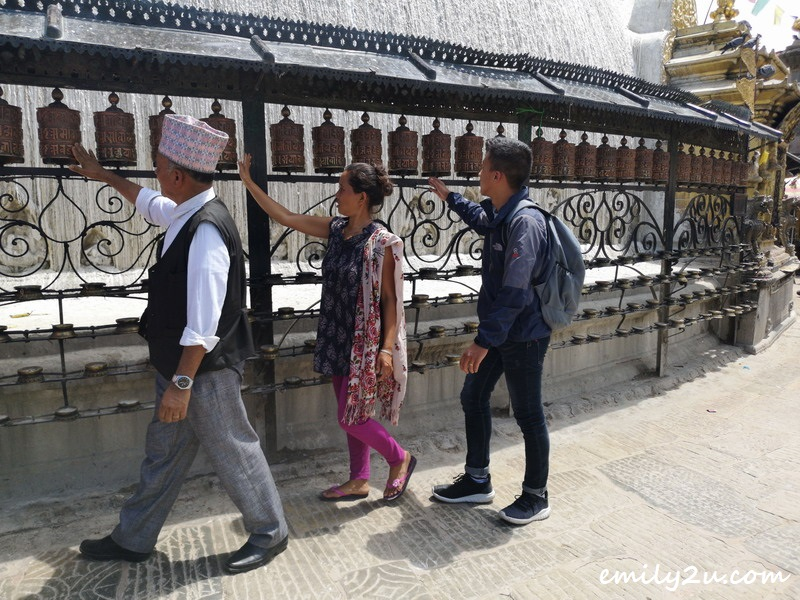 devotees spin the prayer wheels in clockwise direction