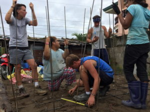 Rayyan (kneeling) working with other volunteers at a site in Tacloban, Philippines for a rebuilding project.