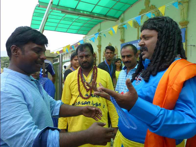 Singampuli consults with the director (left in blue)