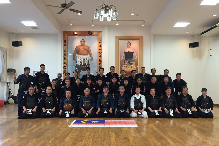 group photo with members of the Chichibu Kendo Association after a joint training
