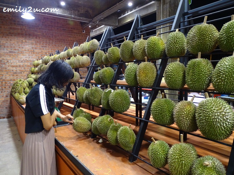 a customer picking and choosing durians