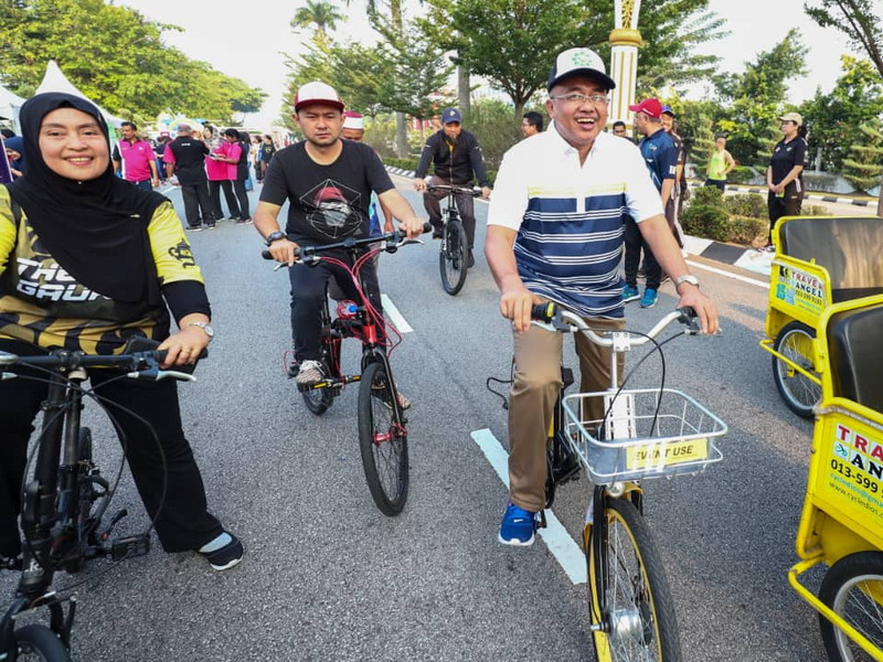 Ipoh City Mayor Dato' Ahmad Suaidi rides a bicycle
