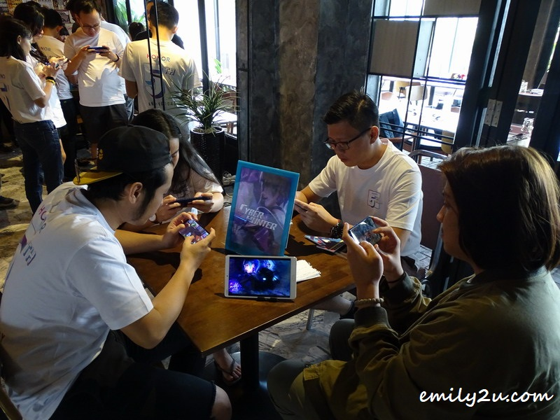 guests at the event playing the latest mobile games