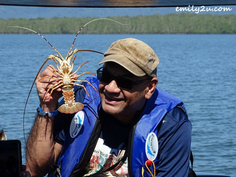 David Hogan Jr. poses with a lobster, freshly caught by a fisherman