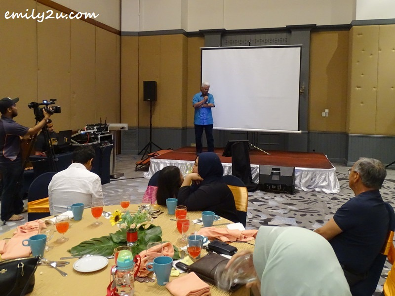 Dato' Roshidi entertains guests with a karaoke track