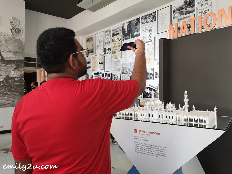 Pavel takes a photo of an exhibit