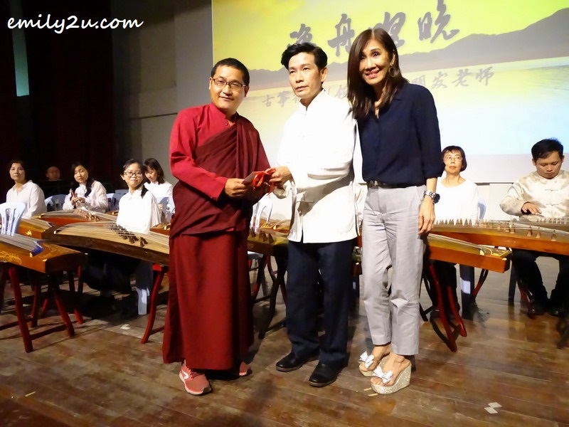 5. Ula Jigmé Tsewang Namgyal Lama (L) receives the money raised by Teoh Beng Huat (Centre), on behalf of the orchestra