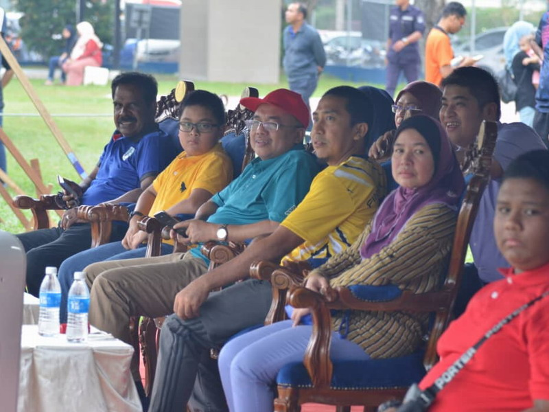 Ipoh City Mayor Dato' Ahmad Suaidi (in red cap) watches the game