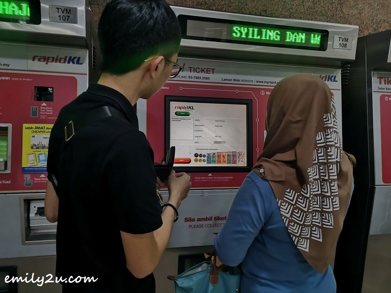 buying LRT tokens for the ride to Pasar Seni