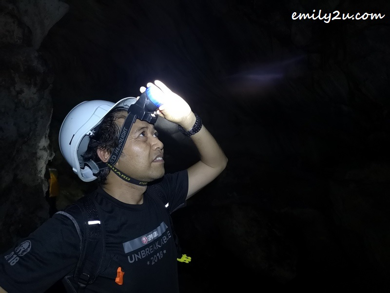 Rosli (Ipoh Echo) shines his headlamp towards the dome of the cave