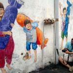 Eka photographs the wall murals