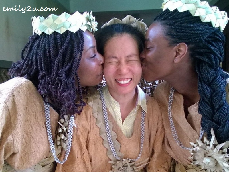 writer as bride in the mock wedding kissed by bridesmaids from France