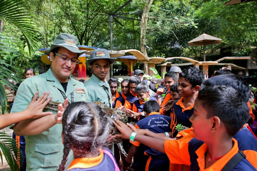 Lost World of Tambun Petting Zoo rangers (in green) educating the visiting school children from B40 group about animals during the #sunwayforgood Deepavali Cheer 2019.