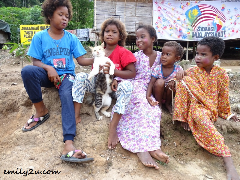 children and a cat