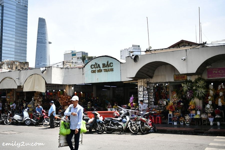 Ben Thanh Market in the heart of Ho Chi Minh City, Vietnam with Bitexco Financial Tower in the background